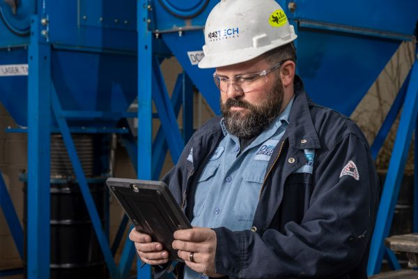 dust collector service technician with tablet